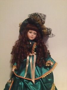 Glass Doll - Great condition. Stand included