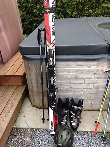 Skis boots poles and helment