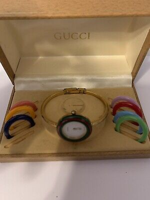 Gucci womens watch vintage with interchangeable bezels gold plated S/N 0301170
