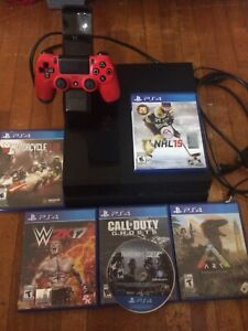 PS4 barley used with 6 disk games 1 controller and dock