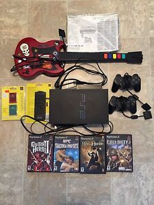Playstation 2 w/4 games, 2 Controllers, Remote, Guitar
