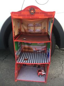 Firetruck plus foldable Firehouse Playhouse/Clothing Unit