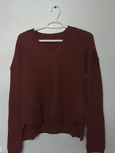 Soft red long sleeved cute sweater