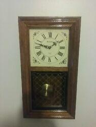 Bulova quartz chiming pendulum wall clock.