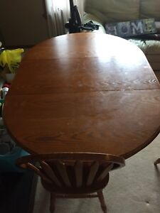 Solid hardwood oval extension table