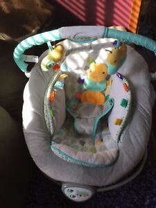 Infant bouncer cradle seat