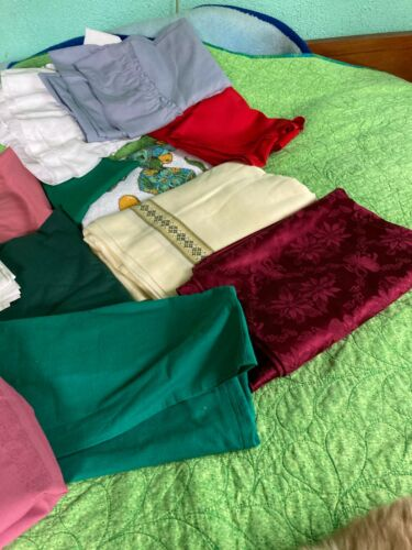 assorted lot of 12 tablecloths  all sizes round and square