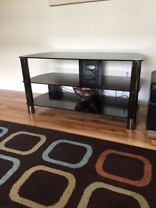 Tinted black glass tv stand