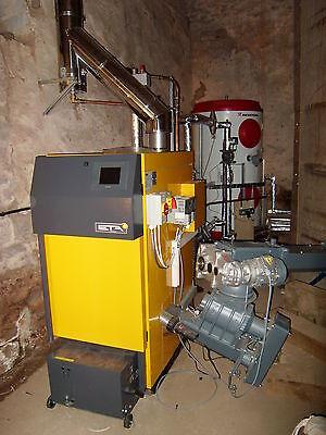ETA Hack 50 (13.6 to 49.5kW) Wood Chip Boiler System and 1,000 litre Akvarterm accumulator tank.