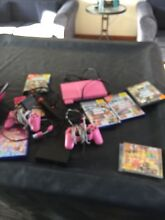 Pink PlayStation 2 complete with sing star and games near new Melton West Melton Area Preview