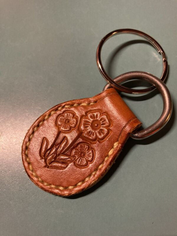 Leather Key ring Hand Sewed And Stamped. Flower design.