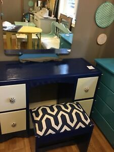 Navy blue vanity with mirror and stool