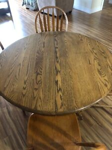 Solid Oak Pedestal table with 4 chairs