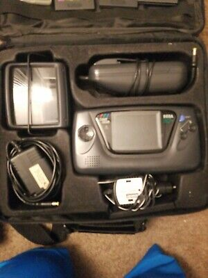 Sega Game Gear with games and accessories  (Game Gear Accessories)