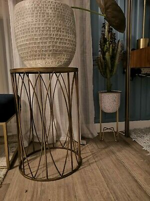 Antique brass and textured glass plant table