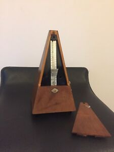 Vintage Germany (GDR) wooden metronome with bell.