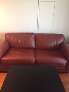 Leather sofa / couch / chair for sale. Turns into a queen bed