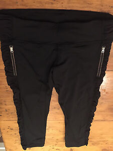 Lululemon running crops with zippers and mesh sides.  Size 10.