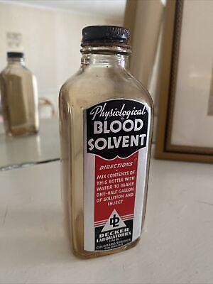 vintage glass embalming fluid bottle