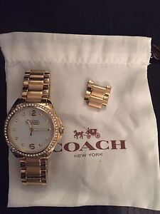 Coach watches. Gold tone and silver tone.