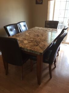 Dining table with 6 chairs plus matching hutch