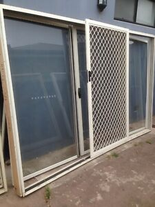 Large 3 panel prime rose aluminium sliding door with security grill