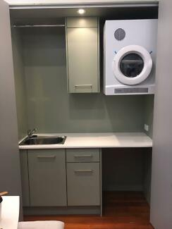 Laundry Cabinetry Sink And Ironing Board With Dryer Included