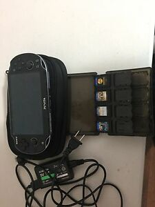 Like new Ps vita with 5 games and accessories.