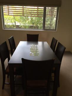 Dining table and matching chairs for sale