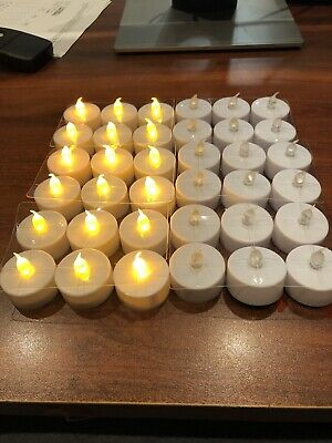 144 Flameless LED Tea Light Candles Battery Powered Unscented New In Box ()