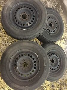 Set of 4 tires w/rim. P215/70R15 grand prix. 80% left