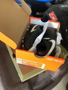 Brand New in Box kids soccer cleats size 13.