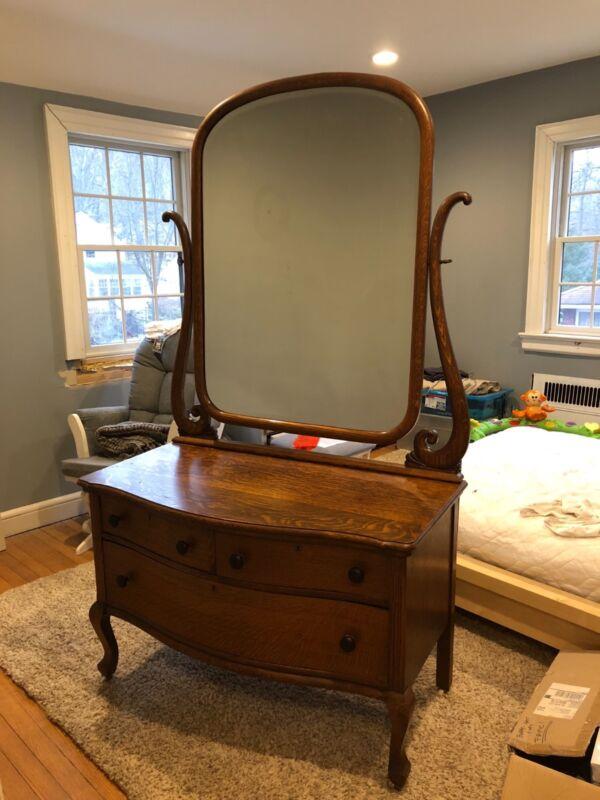 antique tiger wood vanity with beveled mirror