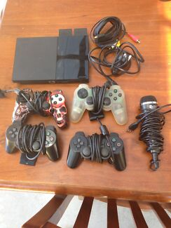 Play Station 2 - 39 games, 4 controllers, mic & console