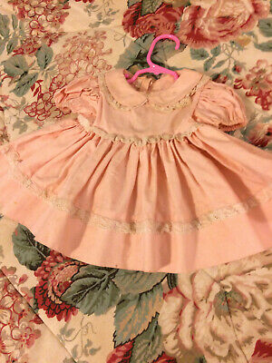 Pink vintage doll dress with lace and ruffles