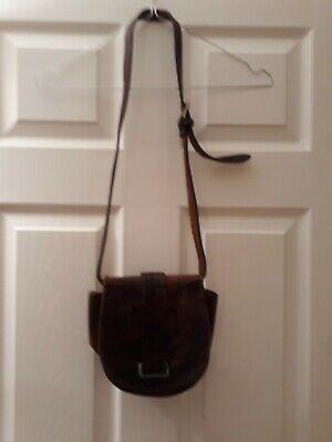 Vintage 70s tooled floral embossed leather shoulder bag with buckles rich brown.