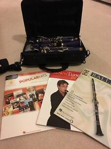Clarinet, case and 3 music books