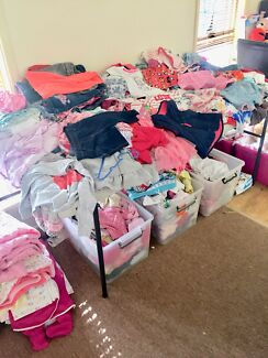 Baby girl clothes, toys and accessories, new and used.