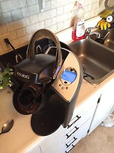 Keurig. Doesn't have the water holder