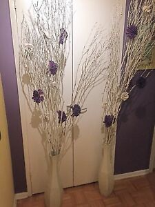 White metal vases with decorative branches