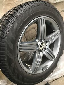 Like New 5 bolt winter wheels and tires