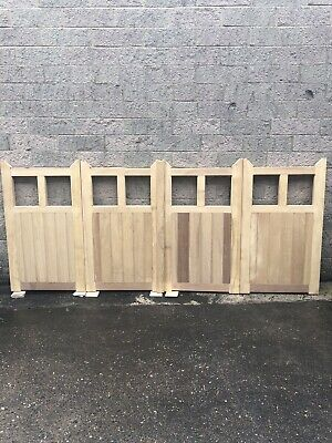 BI-FOLDING DRIVEWAY GATES MADE FROM IROKO HARDWOOD.  9ft Wide X 5ft  High