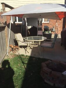 Round patio table and 4 chairs for sale