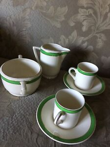 Tea cups/saucers with cream and sugar holder