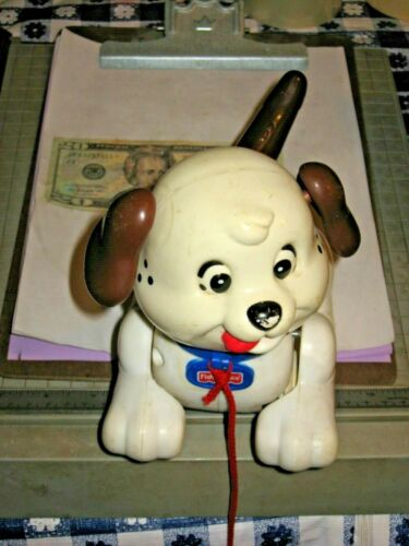Fisher-Price H9447/M2110 Pull Puppy Dog Toy it has some scuff marks legs.