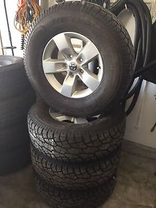 2016 Dodge Ram 17 inch OEM wheels with almost new tires