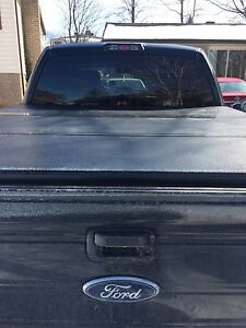 Tri- Fold hard top tonneau cover off a 2013 F150 short box (5.5)