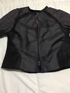 Icon riding jacket with rube inserts