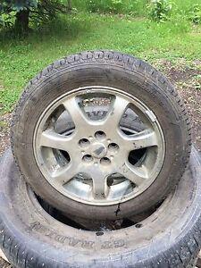 One dodge neon rim and tire  185/60R15