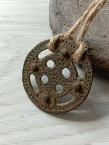 Amulet wheel of Ancient Celts with solar symbols.